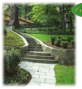 custom stonework stairs and walkway with landscaping